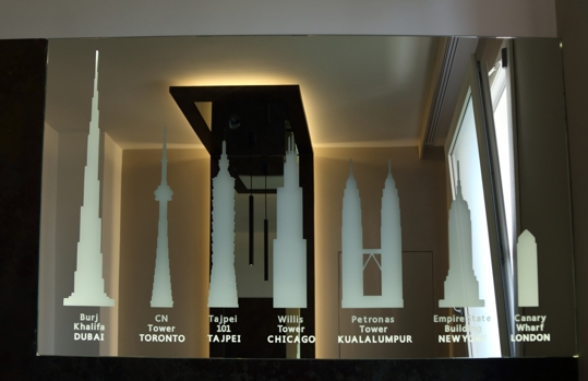sandblasted and back-lit mirror depicting the highest skyscrapers in the world