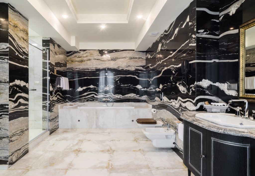 One of the suite bathrooms with white and black contrast marbles